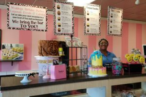 Malaika Marks behind her counter of goodies!