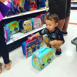 Asher helps pick out ALL the lunch boxes