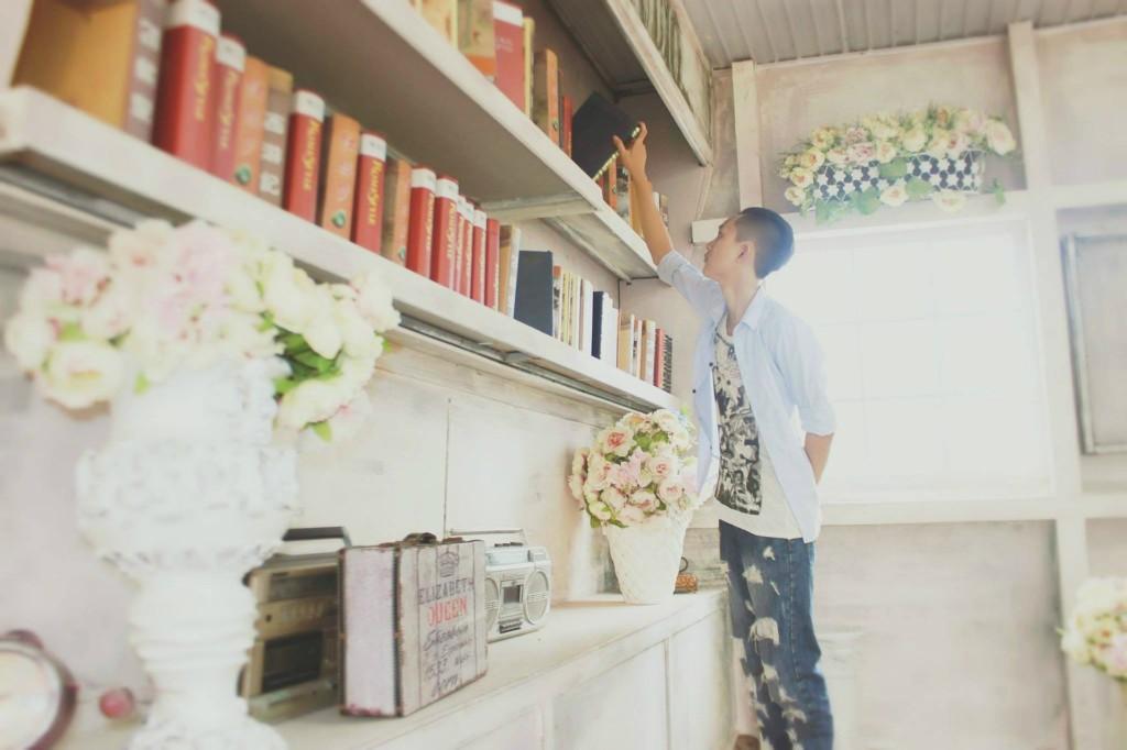 Boy choosing book Albuquerque Moms Blog