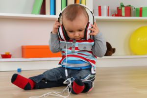 Portrait of a baby listening to music with headphones for Albuquerque Moms Blog