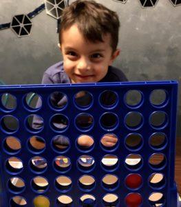 boy plays connect 4, Albuquerque Mom's Blog