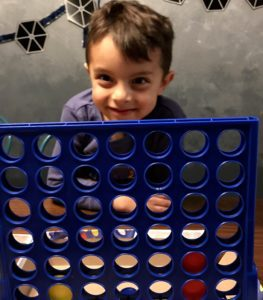 child playing connect 4 albuquerque mom's blog