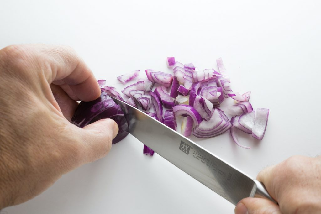 knife cutting onion